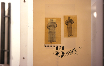 two-sided photo transfer on rice paper, Letraset, montage, plexiglass and steel hinged frame, 2005